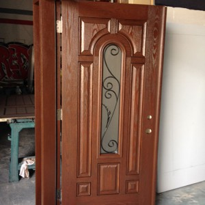 8 Panel Fiberglass Woodgrain Front Doors with Clear Glass Side Lites and Transom with Iron Art Designs During Manufacturing by windowsanddoorstoronto.ca