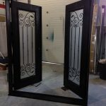 Fiberglass Woodgrain Doors with Wrought Iron Design & Frosted Glass Manufactured by Widows and Doors Toronto