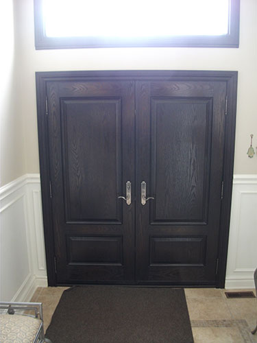 Wood Grain Double Doors with Transom and Multi Point Locks, Inside View Installed by Windows and Doors Toronto