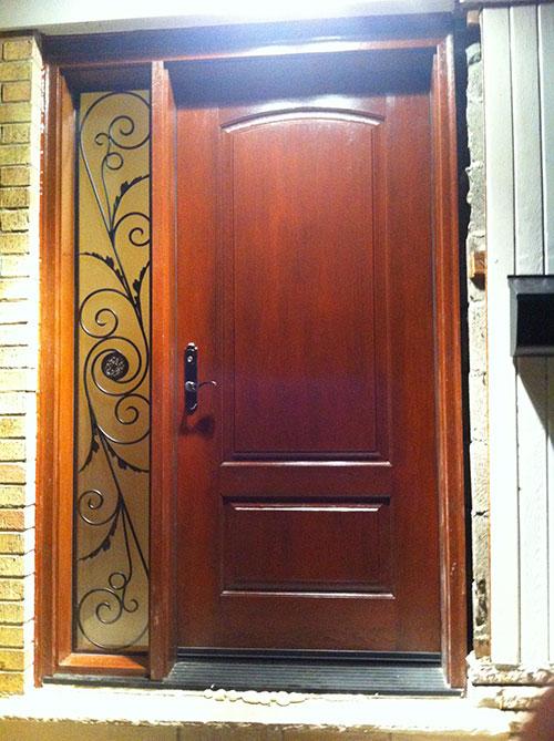 Wood Grain Fiberglass Door with Iron Art Design Side Lite Installed by Windows and Doors Toronto