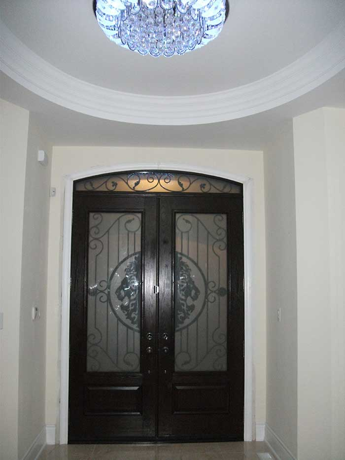 Wood grain Fiberglass Door with Matching Iron Arch Transom Installed by windows and doors toronto in Oakville - Inside View
