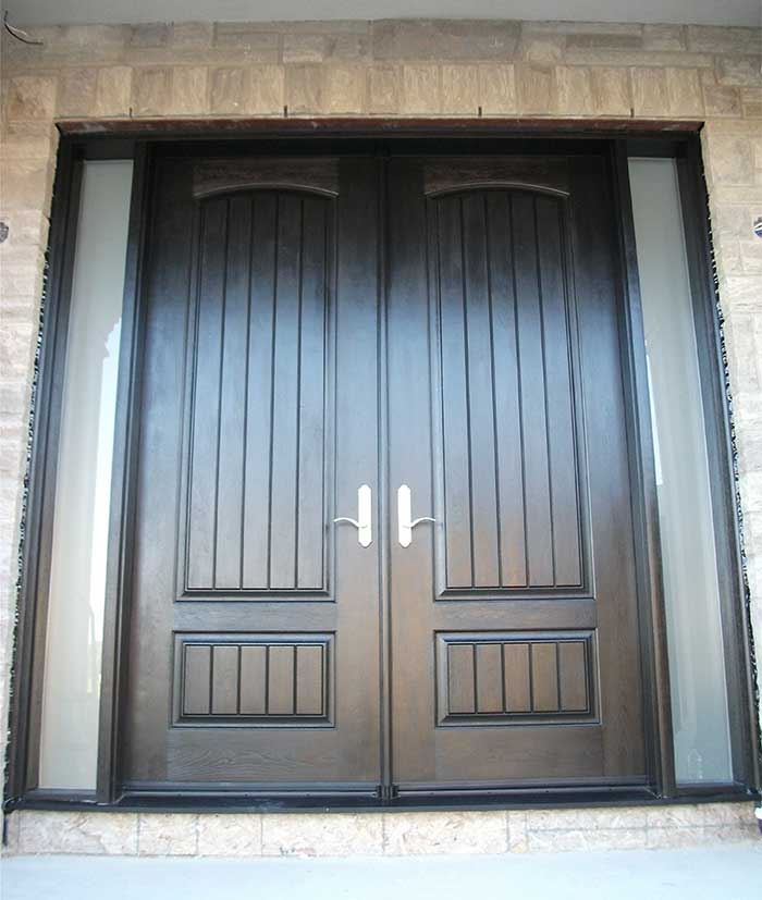 Wood grain Fiberglass Doors With Rustic and 2 Frosted Side Lites installed by Windows and Doors Toronto in Richmondhill
