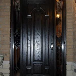 Wood grain Front Door With 2 Side Iron Art Lites Installed by windows and doors toronto in Barrie Ontario