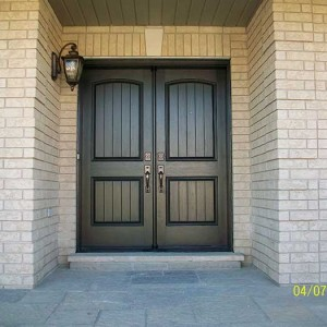 Wood grain Rustic Fiberglass Parliment Doors with Multi Point Locks Installed by Windows and Doors Toronto in Burlington