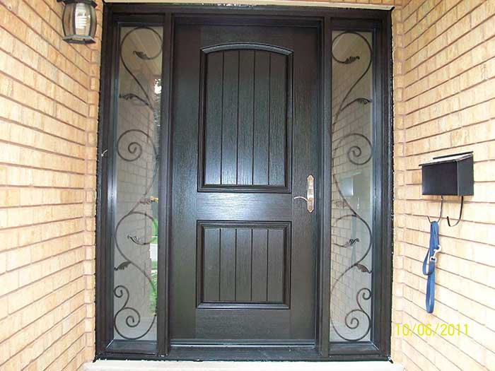 Wood grain Rustic Fiberglass front Single Door with 2 Iron Art Design installed by windows and doors toronto