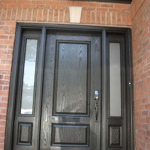 Wood grain Single Solid Door Fiberglass With 2 Side Panel Lights Installed by windows and doors toronto in Toronto