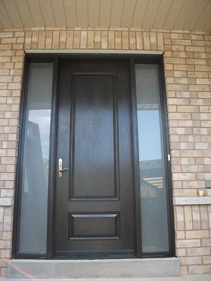 Wood grain Solid Door with 2 Frosted side lites Installed by Windows and Doors Toronto in Maple