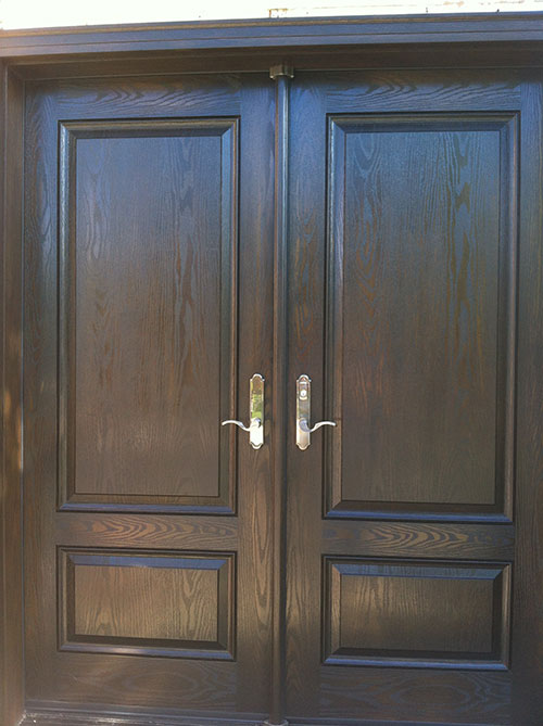 Wood grain Solid Double Doors with Multi Point Locks Installed by Windows and Doors Toronto