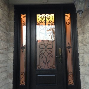 Wrought Iron Fiberglass Door-Woodgrain Door with 2 side lites installed in Oakville by windowsanddoorstoronto.ca