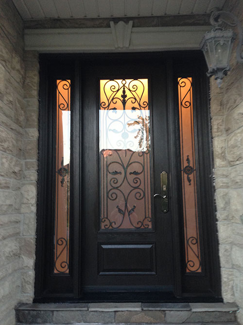 Wrought Iron Fiberglass Door-Woodgrain Door with 2 side lites installed in Oakville by windowsanddoorstoronto.ca