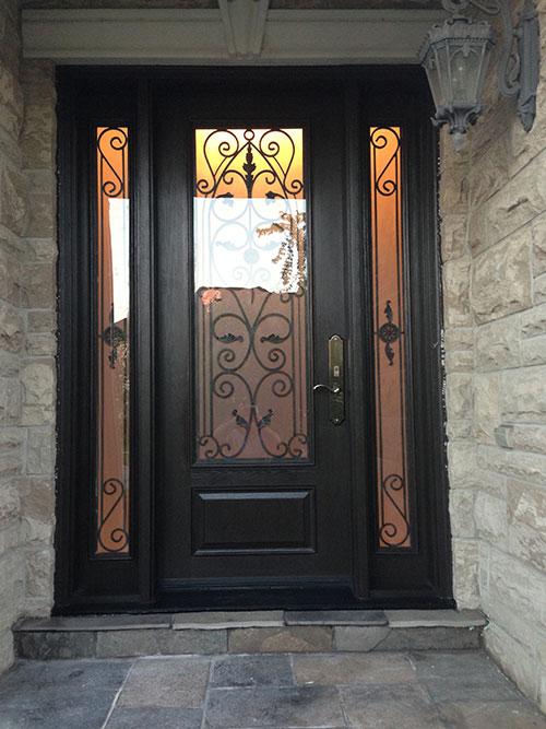 Wrought Iron Fiberglass Door with 2 side lites installed in Oakville by windowsanddoorstoronto.ca
