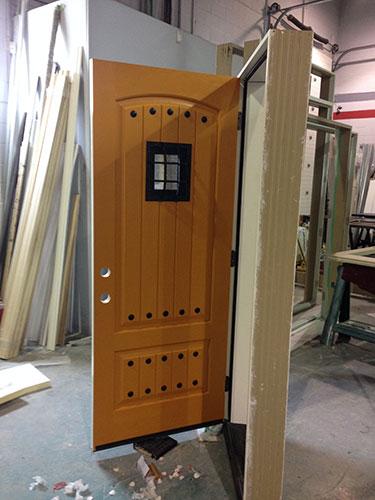 Rustic Fiberglass Door-Fiberglass Rustic Front Entry Door with Easyspeak Medieval Design During Manufacturing by windowsanddoorstoronto.ca