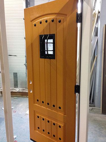 Rustic Front Door-Fiberglass Front Entry Door with Easyspeak Medieval Design During Manufacturing by windowsanddoorstoronto.ca