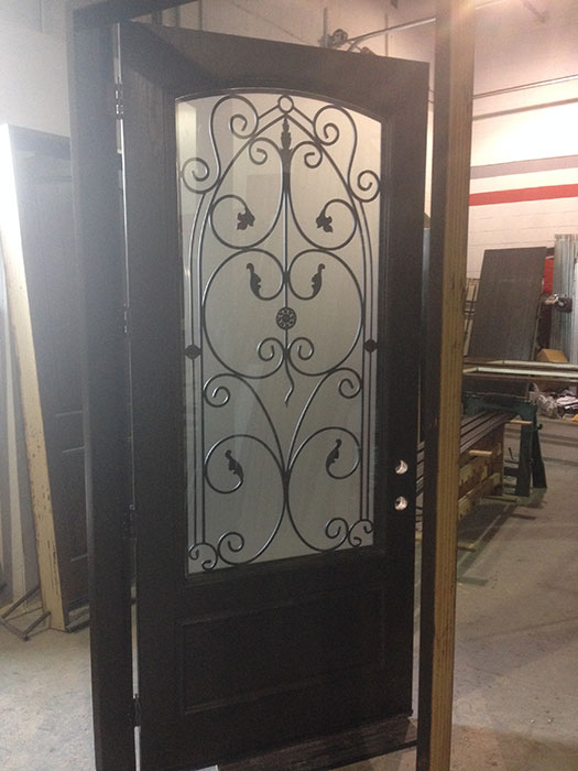 42 inch Oversized Fiberglass Woodgrain With Custom Iron Art and Custom Bottom Panel During Manufacturing by windowsanddoorstoronto.ca