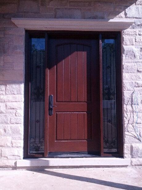 Fiberglass Woodgrain Rustic Front Door with 2 Frosted Side Lites and Iron Art Design installed by windowsanddoorstoronto.ca