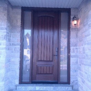 Fiberglass Woodgrain Rustic Front Door with 2 Frosted Side Lites and Multipoint Locks installed by windowsanddoorstoronto.ca