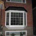 Installation of Bay Window Basement Windows in Toronto.