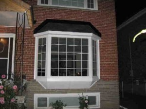 Installation of Bay Window Basement Windows in Toronto.