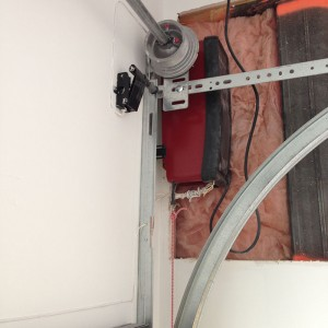 Installation of a Garage Door with a Side Motor in custom house in Oakville by Modern Doors
