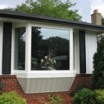 Installation of oversized bay Window withh vinyl siding.