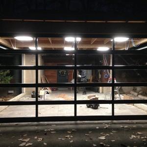 Oversized Aluminum Glass Garage Door DUring The Installation in Custom Home in Oakville by windows and doors toronto