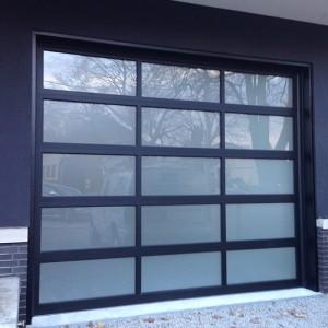 Oversized Aluminum Glass Garage Door in Custom Home in Oakville by windowsanddoorstoronto.ca