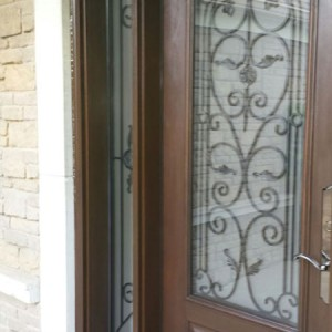 Rustic Wrought Iron Fiberglass Doors With 2 Side Lites Installed in Oakville