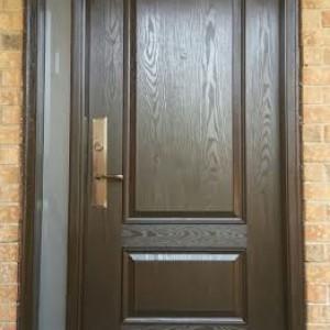 Woodgrain Fiberglass Exterior 2 Panel Door with frosted side lite installed in Toronto by Windows and Doors Toronto