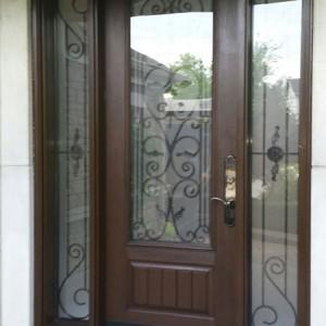 Wrought Iron Fiberglass Doors With 2 Side LItes Installed in Oakville