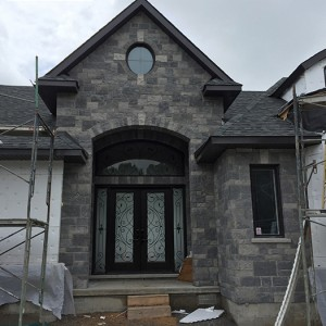 Wrought Iron Fiberglass Double Doors with 2 Iron Art Side Lites installed in new Home in Oakville