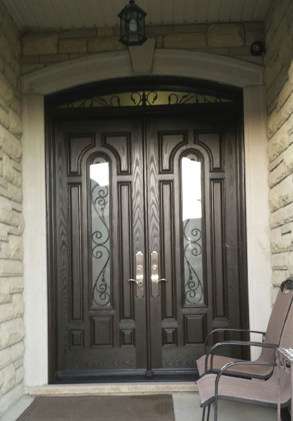 Windows and Doors Toronto-Fiberglass Woodgrain 8 Panel Doors with 2 door lites and Arch Transom Installed in Toronto By Windows and Doors Toronto