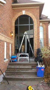 Custom Fiberglass Excutive Door with Clear Side lites and huge Transom Installed in Woodbridge During Installation