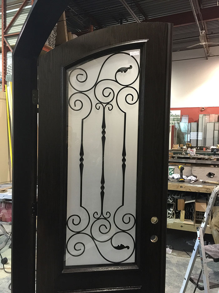 Arched Fiberglass Front Door with Iron Art Design and Frosted Glass During Manufacturing