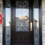 Wrought Iron Fiberglass Woodgrain Door with 2 Side lites and Multi Point Locks Installed in Nobleton By Windows and doors Toronto
