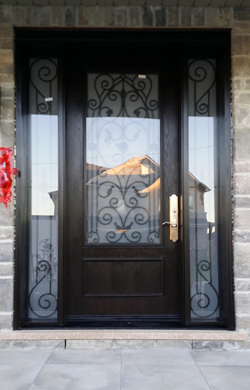 Wrought Iron Fiberglass Woodgrain Door with 2 Side lites and Multi Point Locks Installed in Nobleton