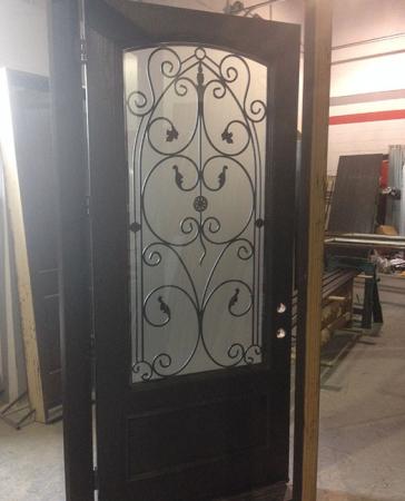 42 inch Oversized Fiberglass Woodgrain With Custom Iron Art and Custom Bottom Panel During Manufacturing by Windows and Doors Toronto