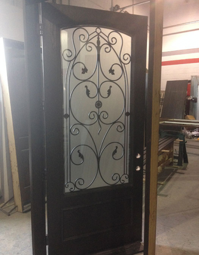 42 inch Oversized Fiberglass Woodgrain With Custom Iron Art and Custom Bottom Panel During Manufacturing by Windows and Doors Toronto