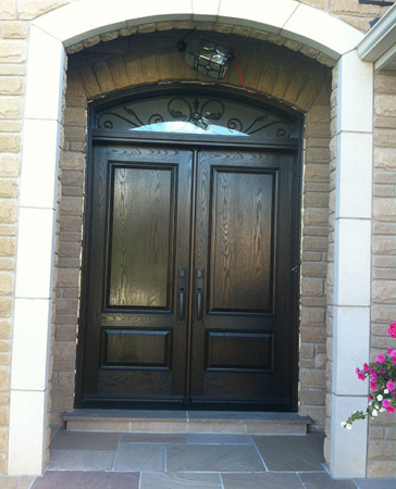 Windows and Doors Toronto-8 Foot Doors-Fiberglass Doors-Woodgrain Fiberglass Solid Double Doors with Arch iron Art Transom Installed in Woodbridge by Windows and Doors Toronto