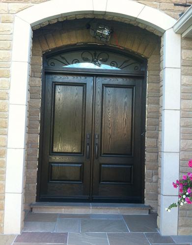 Windows and Doors Toronto-8 Foot Doors-Fiberglass Doors-Woodgrain Fiberglass Solid Double Doors with Arch iron Art Transom Installed in Woodbridge by Windows and Doors Toronto