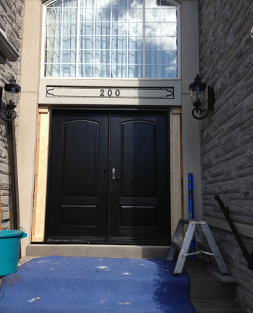 Executive Wood Grain Doors with Multi Point Locks Installed in Oshawa  by Windows and Doors Toronto
