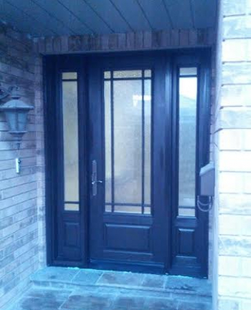 Fiberglass Door-2 panel fiberglass door with frosted glass backing and 2 side lites installed in Oakville
