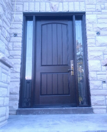 Fiberglass Door-Exterior Door-Rustic 2 panel Front Door with 2 Side lites & Iron Art Design with Frosted Bakcing Glass installed in New Market_ Ontario