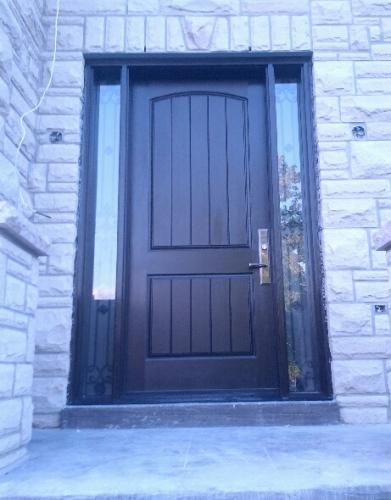 Fiberglass Door-Exterior Door-Rustic 2 panel Front Door with 2 Side lites & Iron Art Design with Frosted Bakcing Glass installed in New Market_ Ontario