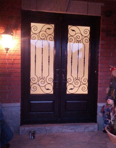 Fiberglass Doors-Extrior Double doors with Iron Art Design and multi point locks installed in Richmond Hill