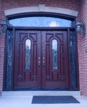 Fiberglass Doors-Fiberglass 8 Panel 8 foot doors with 2 Wrought Iron Design side lites and Transom Installed in Richmond Hill by windowsanddoorstoronto.ca