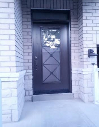 Wrough Iron Fiberglass door-Fiberglass Front Door-Fiberglass Excaliber Design wth frosted glass installed in Thornhill by windowsanddoorstoronto.ca