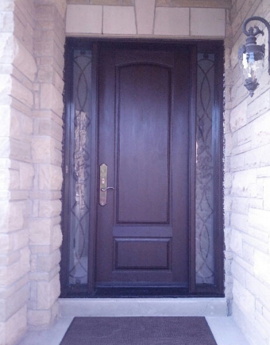 Fiberglass 2 Panel Front Door with 2 Frosted Side Lites installed by windows and doors toronto