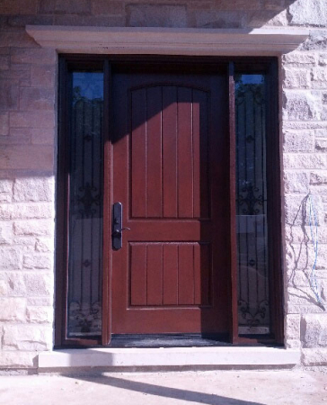 Fiberglass Woodgrain Rustic Front Door with 2 Frosted Side Lites and Iron Art Design installed by Windows and Doors Toronto