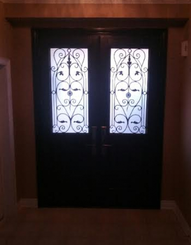Fiberglass Doors-Fiberglass Wrought Iron Doors with multi point locks installed in Richmond Hill by windowsanddoorstoronto.ca