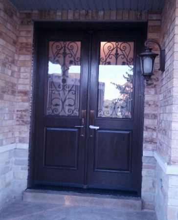 Fiberglass Doors-Fiberglass Wrought Iron Door with multi point locks installed in Richmond Hill by windowsanddoorstoronto.ca